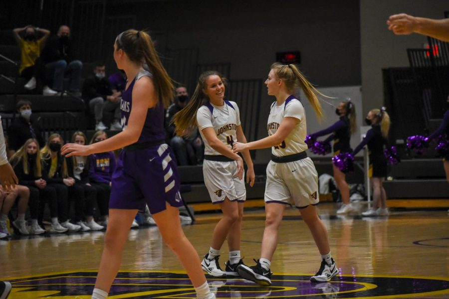 Zoey Buchan 22 and Anna Gossling 22 enjoying the moment after an Indianola turnover. The girls beat Indianola High 84-61.
