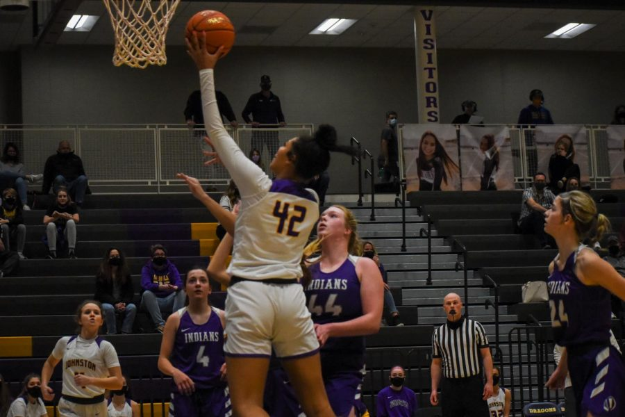 Jada Gyamfi 22 drives the ball to the lane for a contested layup. The girls beat Indianola High 84-61.