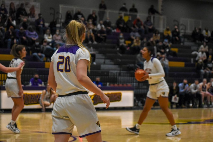Anna Gossling 22 waits for the play to develop to make her move. The girls beat Indianola High 84-61.