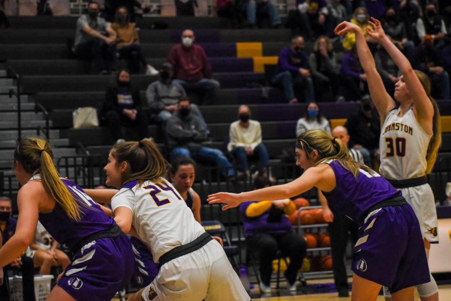 Molly Noelck 23 fights to rebound the ball after a free throw. The girls beat Indianola High 84-61.