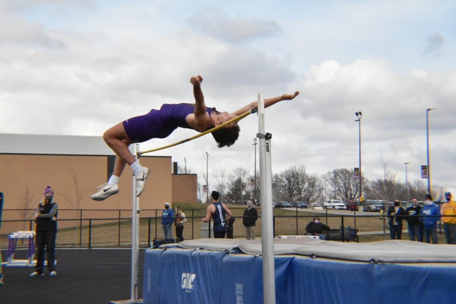 Karter Kriegel '21 jumps over the bar in boys Varsity high jump. He placed 4th in varsity with a height of 5' 4