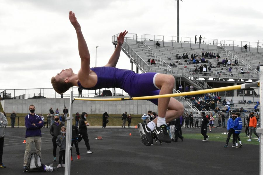 Steven Kramer jumps over the bar in the JV high jump. Kramer placed second in Jv with a height of 5' 8