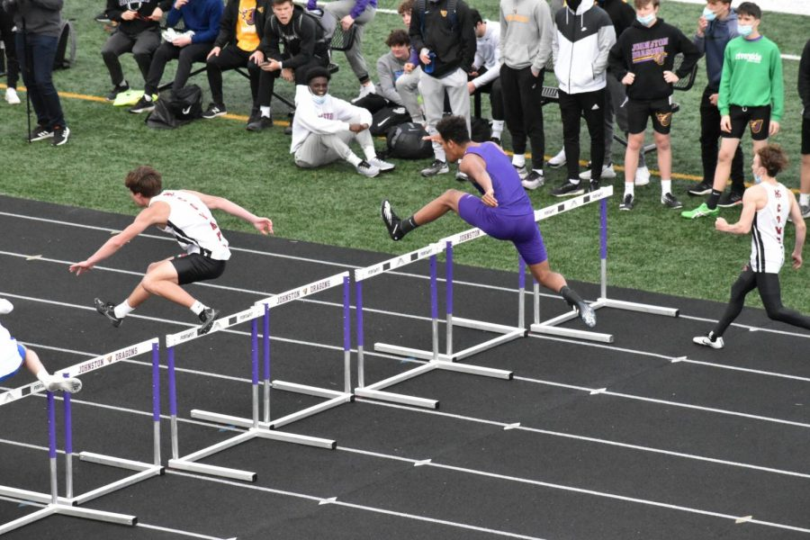 Tavian Pope soars over the second hurdle in the mens shuttle hurdle relay.