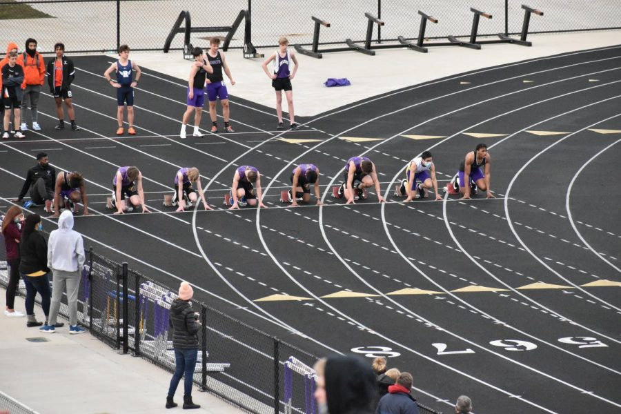 The runners line up at the start of the JV 100 meter dash.