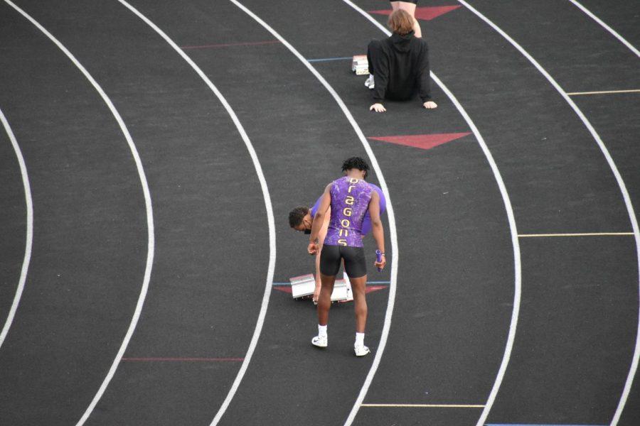 Donnie Henderson prepares to run the mens 400 hurdles. '22