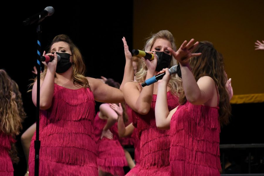 (Left to Right) Mia Mattingly '22, Emily McLaughlin '21, Emma Erdoes '21, singing their bold and sassy trio in the girls song.
