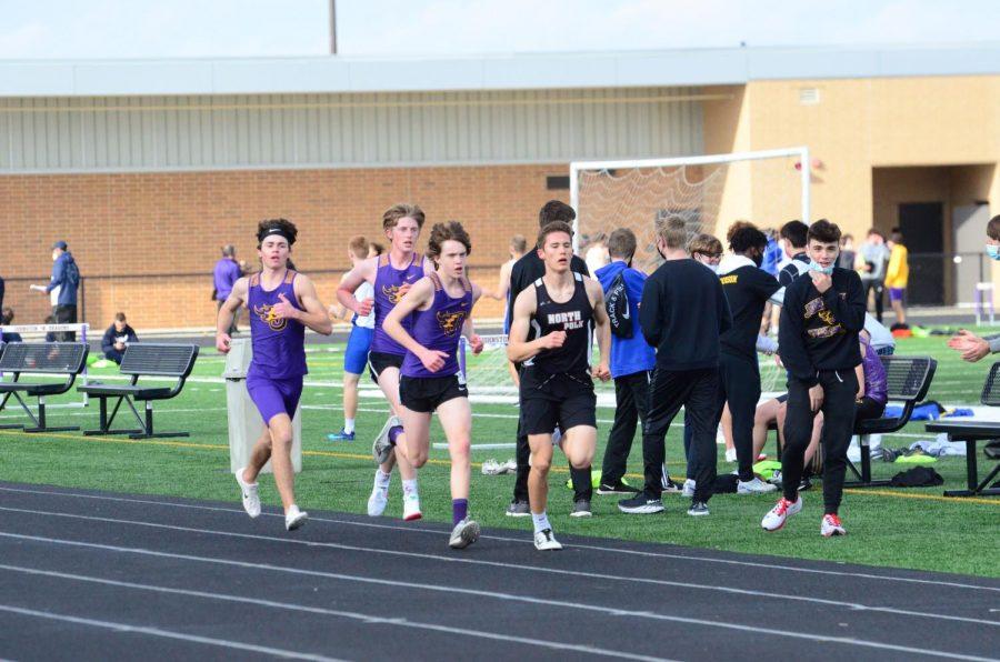 Stephen Beaman '22, Jake Wagner '22, Aiden O'Conner run in the Varsity 3200 meter race.