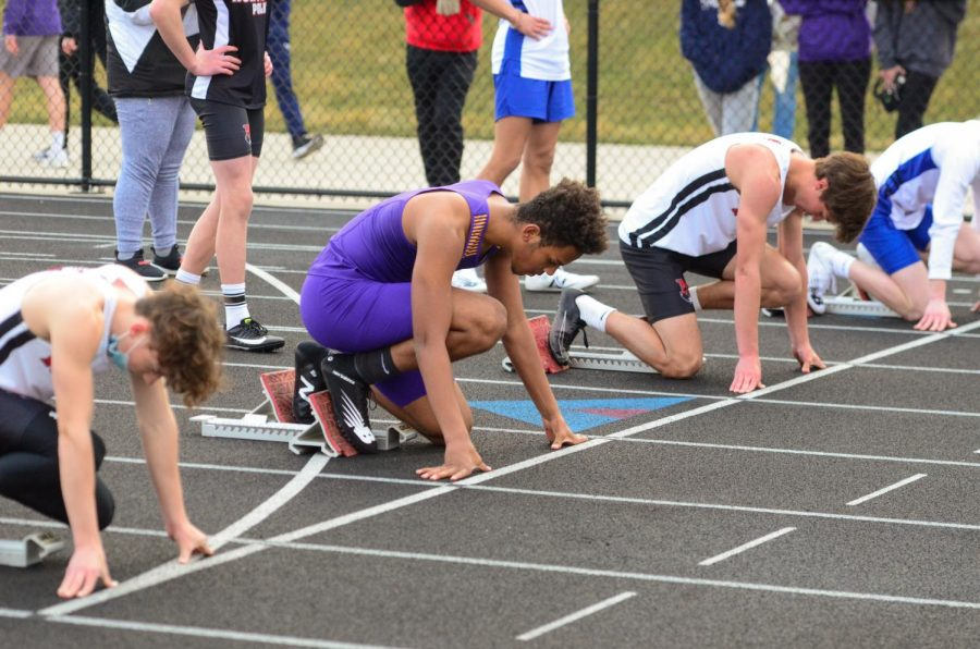Tavian Williams '22 getting ready for the 4x110 meter shuttle hurdle JV race.