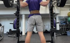 Johnston football recruit Jack Rutz '22 prepares to squat weight on Monday, March 8th.
