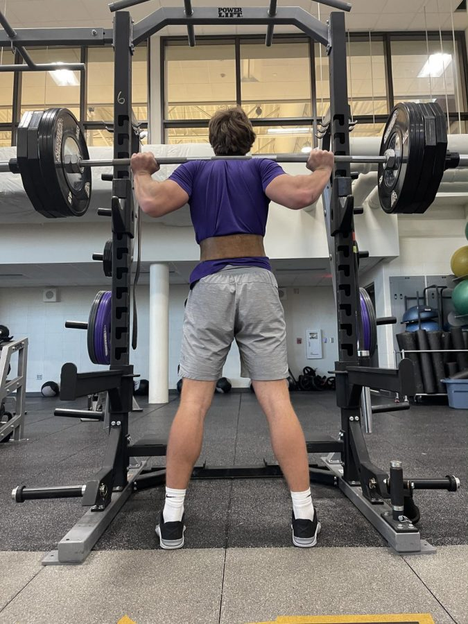 Johnston+football+recruit+Jack+Rutz+%2722+prepares+to+squat+weight+on+Monday%2C+March+8th.