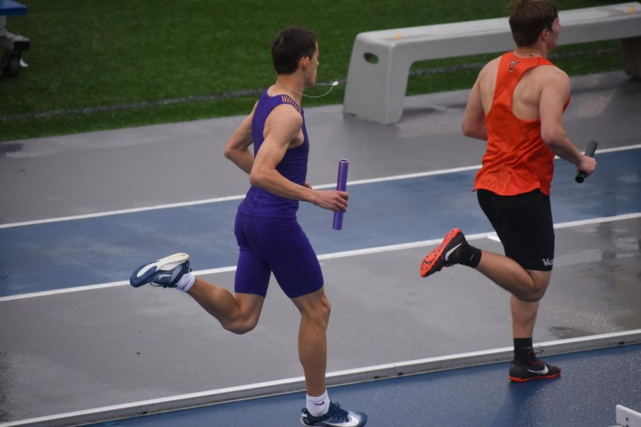 Alex Wear '23 sprinting the third leg  in the 4x800 meter relay.