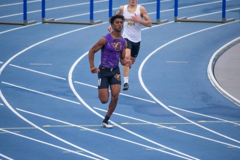 Donnie Henderson '22 running in the last 100 meter stride of the 400 meter hurdle race. Ending with a time of 1:03.29.