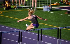 Cierra Wheeler '21 jumping in the girls 4x100 meter shuttle hurdle relay.