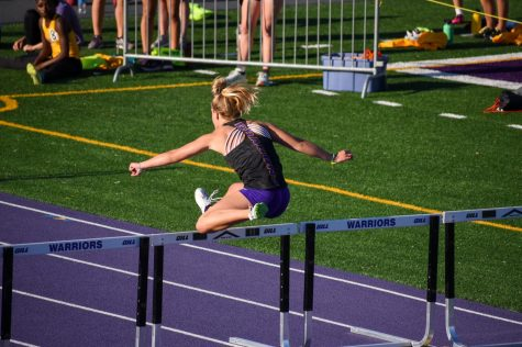 Cierra Wheeler 21 jumping in the girls 4x100 meter shuttle hurdle relay.