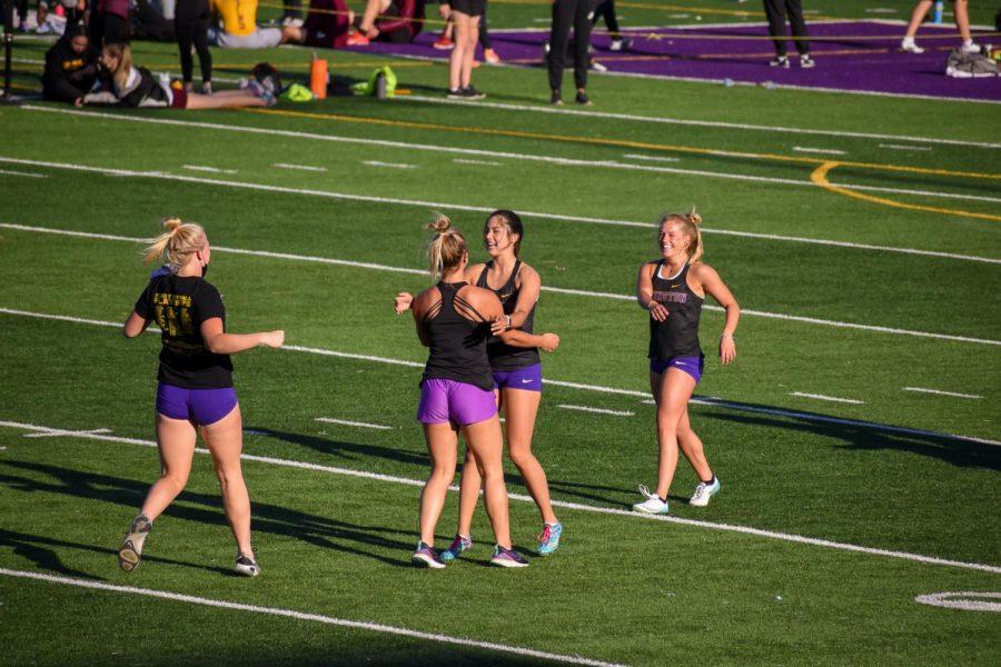 Maren Rasmussen '22, Ella Smithson '24, Ava Smithson '22, Ciara Wheeler '21, congratulating each other after finishing their 4x100 meter shuttle hurdle relay.