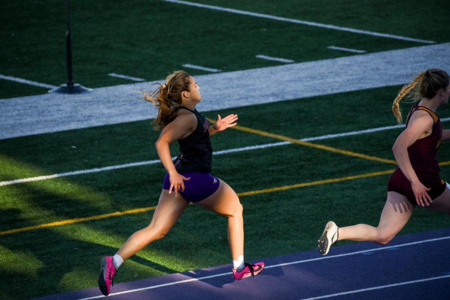Alyssa Miner '22 sprinting in the girls 100 meter dash.