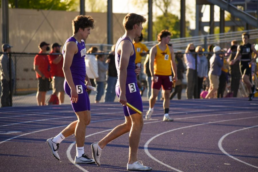 Nick Bechtel '22 preparing to run the first 200 meters in the boys distance medly relay.