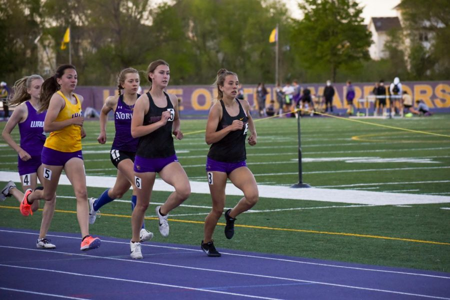 Bella Heikes '21 and Krissy Spear '24 leading the way in the girls 1500 meter run.