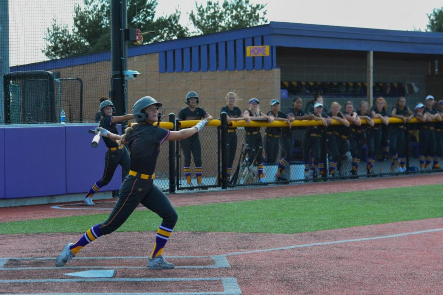 Paige Peterson '23 hits an Urbandale pitch during the first of two games on June 23, 2021.