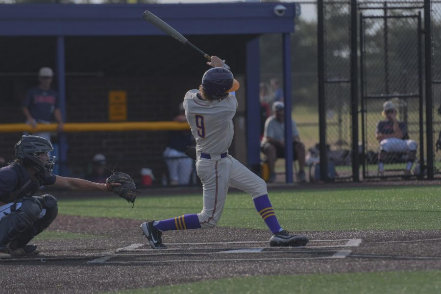 Miles Risley '22 takes a swing at a pitch against Urbandale on June 23, 2021.