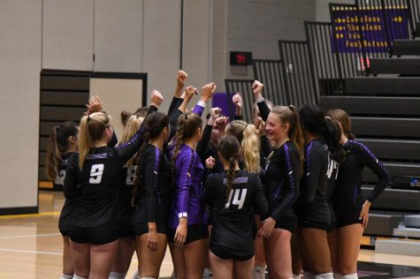 Team comes together to break down before the start  of the game. The Dragons swept through the dodgers winning 3 out the 3 sets.